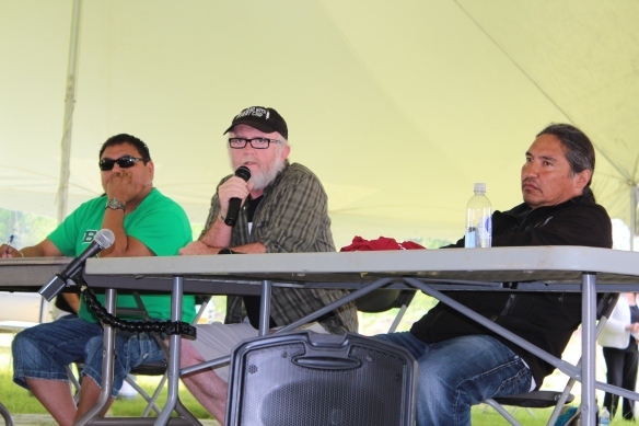 Dr. John O'Connor (centre) speaks about health impacts of oilsands development on a panel with Mikisew Cree member George Poitras (left) and Athabasca Chipewyan First Nation Chief Allan Adam (right)