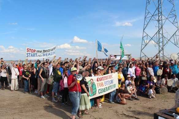 "Participants in a June 2014 ""healing walk"" around oilsands facilities stop near a pond filled with toxic tailings waste."